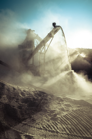 productions: Industrial background with working gravel crusher Stock Photo