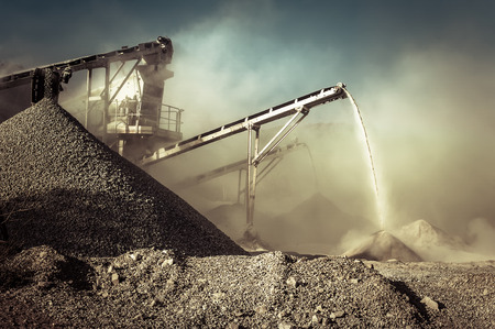 Working Environment: Industrial background with working gravel crusher Stock Photo