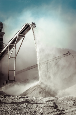 Industrial background with working gravel crusher 스톡 콘텐츠
