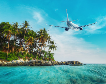 Airplane flying over amazing ocean landscape with tropical island. Thailand travel destinations
