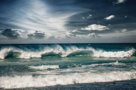 Stormy ocean landscape with rainy clouds