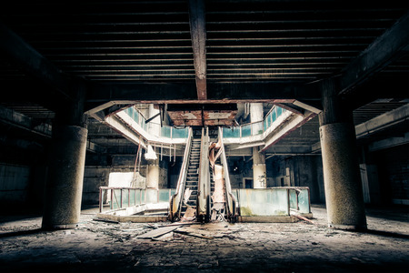 abandoned: Dramatic view of damaged escalators in abandoned building. Apocalyptic and evil concept Stock Photo