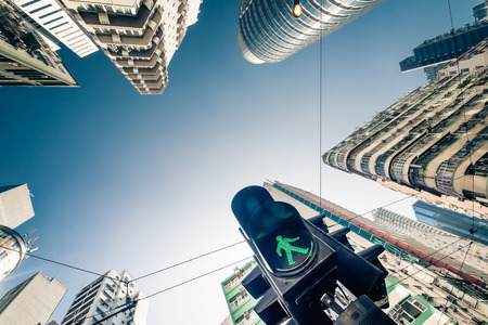 green building: Abstract futuristic cityscape view with modern skyscrapers and traffic semaphore