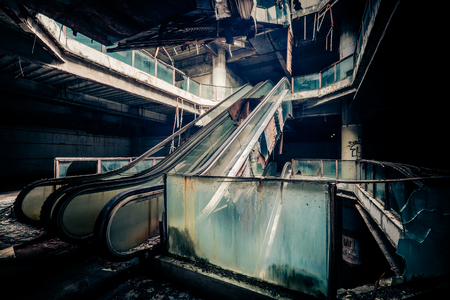 apocalyptic: Dramatic view of damaged escalators in abandoned building. Apocalyptic and evil concept Stock Photo