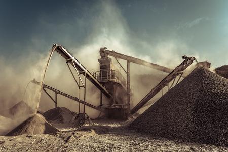 Industrial background with working gravel crusher Foto de archivo