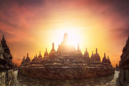 Amazing sunset at Borobudur Temple. World Buddhist heritage and great architecture of 9th century. Java island, Indonesia