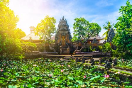 Amazing view of pond with lotus flowers near Pura Saraswati Hindu temple in Ubud, Bali, Indonesia Stock Photo