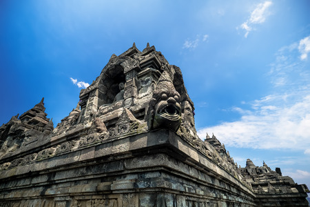 Ancient bas-reliefs depicting Buddhist characters. Highly detailed stone carving of Borobudur temple in Magelang,. Java, Indonesia Archivio Fotografico - 105347168
