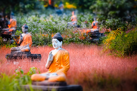 Tilt shift blur effect. Amazing view of lot Buddhas statues in Loumani Buddha Garden. Hpa-An, Myanmar (Burma) travel landscapes and destinations Archivio Fotografico - 101492791