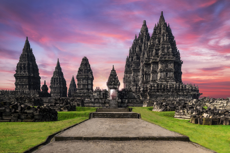 Amazing view of Prambanan Temple against sunrise sky. Great Hindu architecture in Yogyakarta. Java island, Indonesia Banco de Imagens