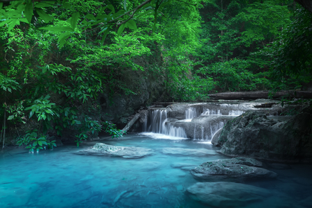 Jungle landscape with flowing turquoise water of Erawan cascade waterfall at deep tropical rain forest. National Park Kanchanaburi, Thailand Archivio Fotografico - 101492793