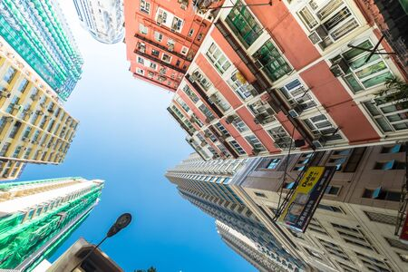HONG KONG - JAN 15, 2015: Abstract futuristic cityscape view with modern skyscrapers and traffic semaphore