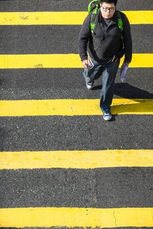 HONG KONG - JAN 17, 2015: Pedestrians people moving on zebra crosswalk at crowded city. Hong Kong