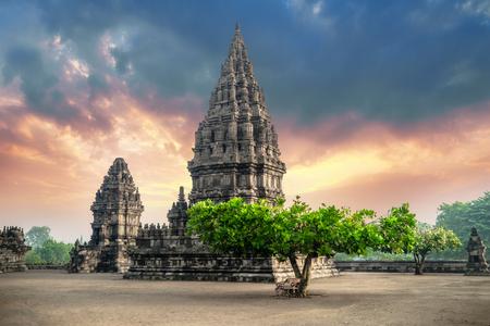 Amazing view of Prambanan Temple against sunrise sky. Great Hindu architecture in Yogyakarta. Java island, Indonesia Archivio Fotografico - 117040152
