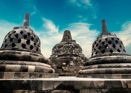Amazing view of stone stupas at ancient Borobudur Buddhist temple against beautiful landscape on background. Great religious architecture. Magelang, Central Java, Indonesia Archivio Fotografico - 117040169
