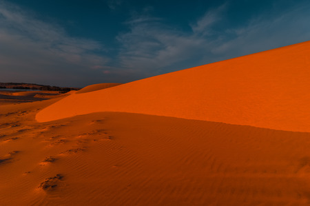 Global warming concept. Stunning view of lonely sand dunes under amazing evening sunset sky at drought desert landscape Stock Photo