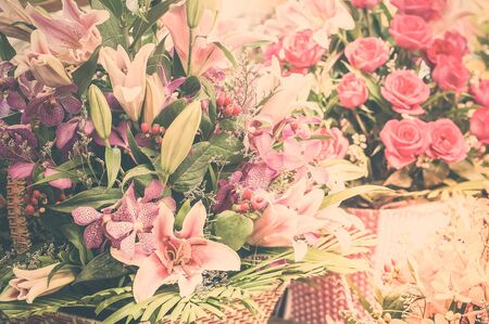 Beautiful different flowers bouquets at street shop. Floral composition in modern shabby chic style