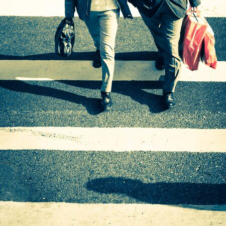Pedestrians people moving at zebra crosswalk. Hong Kong. Crowded city abstract background in vintage style 版權商用圖片