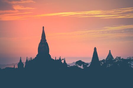 Amazing sunset colors and silhouettes of ancient Buddhist Temples at Bagan Kingdom, Myanmar (Burma). Travel landscape and destinations