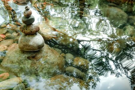 Amazing tropical rain forest landscape with lake and balancing rocks tower for zen meditation practice. Nature background 版權商用圖片