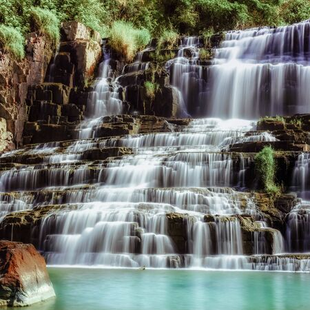 Amazing tropical landscape with flowing water of Pongour cascade waterfall. Da Lat, Vietnam