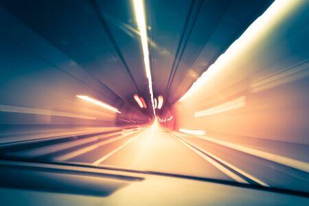 Abstract traffic background. Dark underground tunnel with blurred light tracks. Motion blur