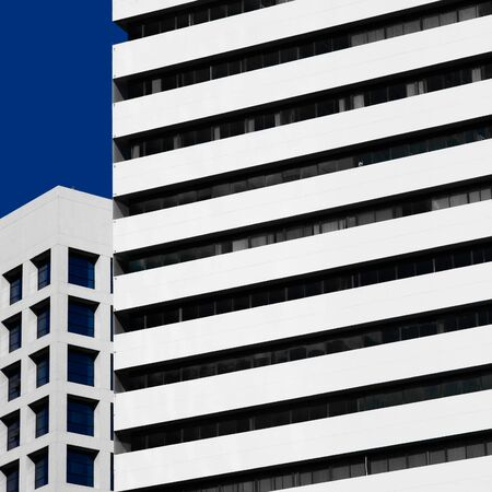 Abstract minimal style architecture background. Modern building facade detail over blue sky Zdjęcie Seryjne