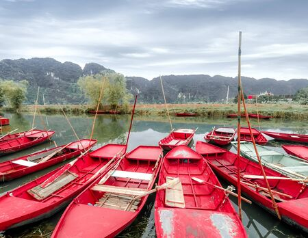 Amazing morning view with Vietnamese boats at river. Tam Coc, Ninh Binh,. Vietnam travel landscape and destinations