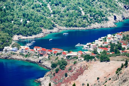 Aerial view panorama of colorful Asos village at Kefalonia island. Greece. Popular destination on Ionian Sea for vacation. Mediterranean port for traveling by yacht and honeymoon paradise.