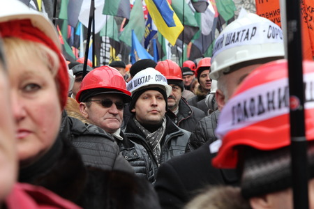 ministers: KIEV, UKRAINE - 28 January 2015: Miners rally around Cabinet of Ministers. People require a provide salaries and increase funding for of the coal industry Editorial