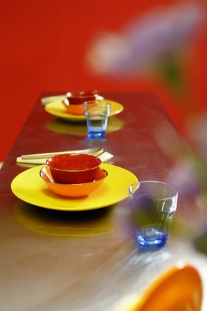 Set of colorful dishes with red background