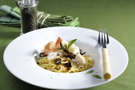 Seafood  pasta with parmigian cheese, basil & olive  Stock Photo