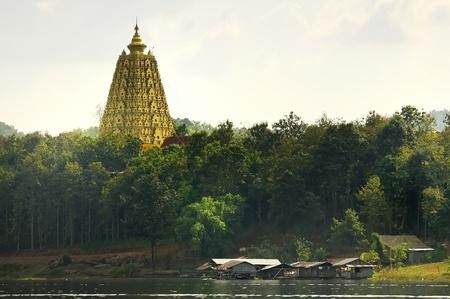 Pagoda at temple Wang Wiwekaram located along the river in the district of Sangkhlaburi. Kanchana Buri province at Thailand.