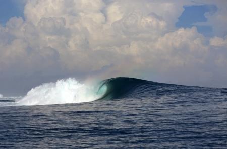 Big blue ocean surfing wave