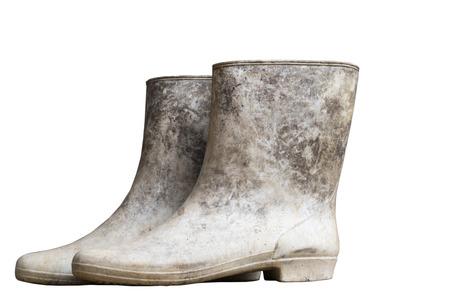 muddy: muddy boots on white background Stock Photo