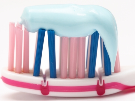 closeup of a toothbrush with toothpaste