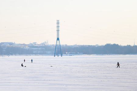 People on the ice of the Baltic Sea in Helsinki photo