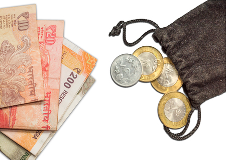 Indian Currency 10 rupee Coins in Bag and notes of 10.20.200 and 500, Stock Photo