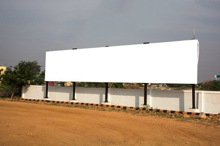 Big Blank billboard with white background space for advertisement in urban india.