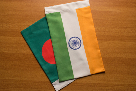 Bangladesh and Indian flags placed on table.
