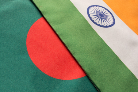 Bangladesh and Indian flags placed on table