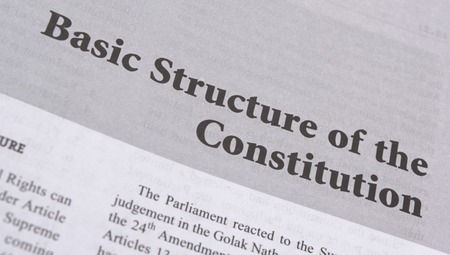 Basic structure of the constitution printed on book with large letters.
