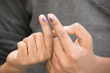 Indian Voter showing voting sign after the polling