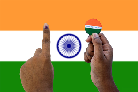 Concept of Indian election,Holding sticker of vote for better Indian on Indian flag as a background Stok Fotoğraf