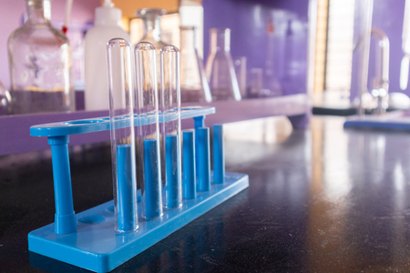 Well arranged lab glassware or empty glass tubes at Empty Science laboratory in university college. Banco de Imagens