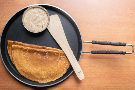 Maida Dosa with Coconut chutney in tawa, south Indian breakfast. Stock Photo
