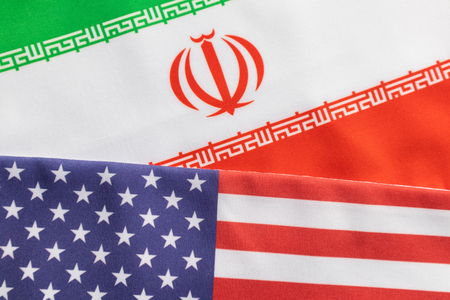 Concept of bilateral relations of US and Iran showing with flag.