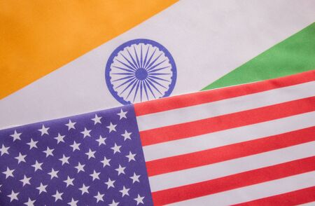 Concept of Bilateral relationship between two countries showing with two flags: United States of America and India
