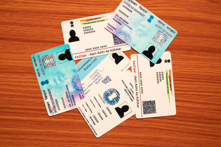 Maski,Karnataka,India - June 26, 2019: Aadhaar card, Ration card, Voter ID and Pan card which is issued by Government of India as an identity card Banque d'images - 125989551