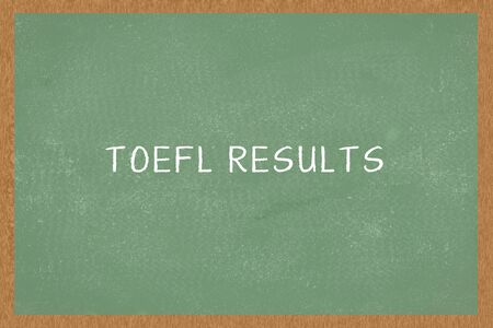 Word TOEFL RESULTS, on Chalkboard background. Test of English as a Foreign Language concept of TOEFL exam